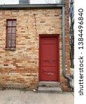 stone building with red door... | Shutterstock . vector #1384496840