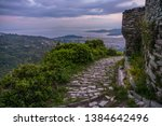 a stony road going down from a... | Shutterstock . vector #1384642496