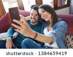 shot of happy young couple... | Shutterstock . vector #1384659419