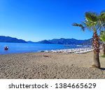 view of sunbeds on the beach in ... | Shutterstock . vector #1384665629