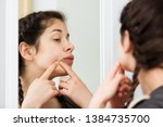 young girl cleaning pores in... | Shutterstock . vector #1384735700