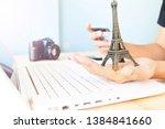 hands holding eiffel tower...   Shutterstock . vector #1384841660