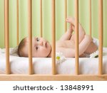 a smiling baby girl lying in a... | Shutterstock . vector #13848991