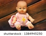 Baby Doll On Wooden Background...