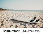 surfboard on sand tropical...   Shutterstock . vector #1384961546