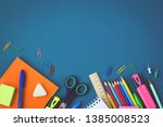 school supplies on blue... | Shutterstock . vector #1385008523