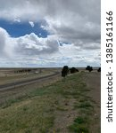 empty highway under a cloudy sky | Shutterstock . vector #1385161166