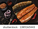Stock photo smoked marinated mackerel fillets or fillet herring fish with spices greens and slice of bread on 1385265443