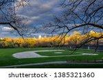 dusk falls on a little league... | Shutterstock . vector #1385321360