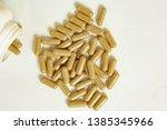 pills scattered on the table | Shutterstock . vector #1385345966
