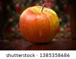 red ripe apple on a colorful... | Shutterstock . vector #1385358686