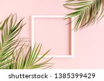 white frame and tropical palm... | Shutterstock . vector #1385399429