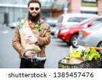 happy stylish man with shopping ... | Shutterstock . vector #1385457476