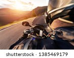 pov of motorcycle driver riding ... | Shutterstock . vector #1385469179