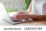 freelance woman working with... | Shutterstock . vector #1385495789