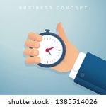 hand holding a stopwatch timer...   Shutterstock .eps vector #1385514026