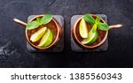 cold moscow mules cocktail with ... | Shutterstock . vector #1385560343