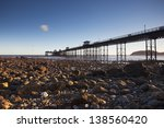 Pier On Seafront At Sunrise In...
