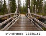 Wooden Bridge In A Forest Alon...