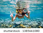 Happy Young Woman Swimming...