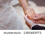 bride hand with engagement ring | Shutterstock . vector #1385683973