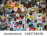 Small photo of TOKYO, JAPAN - MARCH 25, 2019: Doors of commercial premises on a street Токио covered numerous multicolored stickers.Tokyo, Japan