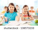 portrait of two diligent girls... | Shutterstock . vector #138573233