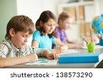 portrait of cute schoolboy... | Shutterstock . vector #138573290