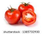 fresh tomatoes isolated on... | Shutterstock . vector #1385732930