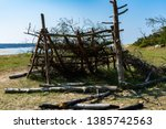 hut left by young people in the ... | Shutterstock . vector #1385742563