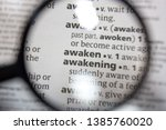 Small photo of The word of phrase - awaken and awakening - in a dictionary.