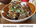 braised rabbit with belgian ale ...   Shutterstock . vector #1385769260