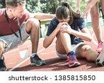 female athlete getting injured... | Shutterstock . vector #1385815850