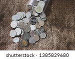 saving money  thai money in the ... | Shutterstock . vector #1385829680
