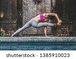 asian woman doing yoga fitness... | Shutterstock . vector #1385910023