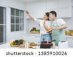 romantic young asian couple... | Shutterstock . vector #1385910026