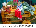 Grandma Doll On A Wooden Cart...