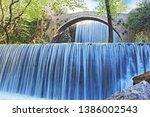 double waterfalls of... | Shutterstock . vector #1386002543