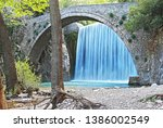 the waterfall of palaiokaria in ... | Shutterstock . vector #1386002549