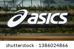 Small photo of Osaka, Japan - March 29, 2019 : Asics logo in front of store in Japan. Asics is a Japanese multinational company which produces footwear and sports equipment