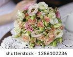 wedding bridal bouquet lies on ...   Shutterstock . vector #1386102236