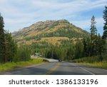 wyoming  usa  july 2018  scenic ... | Shutterstock . vector #1386133196