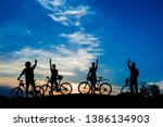 cyclists waving with hands on... | Shutterstock . vector #1386134903