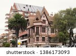 Beautiful european style building resembling an old castle called Villa Normandy among modern buildings. a mix of old and new style architecture