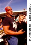 Small photo of LOS ANGELES - circa 1991: Wrestling star Hulk Hogan and his wife Linda Hogan leave an auto repair garage.
