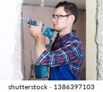 young professional builder... | Shutterstock . vector #1386397103
