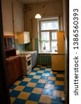 Small photo of Kitchen in an old communal apartment, where three families cook food on one stove, a communal apartment in St. Petersburg in Russia