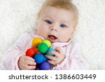 cute baby girl playing with... | Shutterstock . vector #1386603449