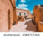 beautiful narrow old street in...   Shutterstock . vector #1386717263