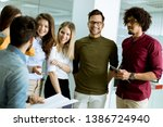 multiethnic group of young... | Shutterstock . vector #1386724940